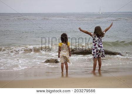Two young girls admiring the beach in Monterey California