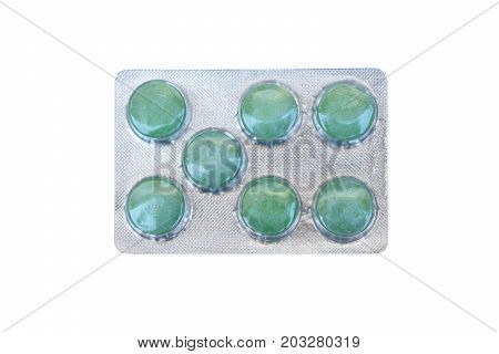 Candy in a blister package isolated on white