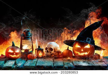 Halloween In Flame - Burning Pumpkins On Wooden