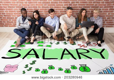 Group Of Diverse People Looking At Salary Concept