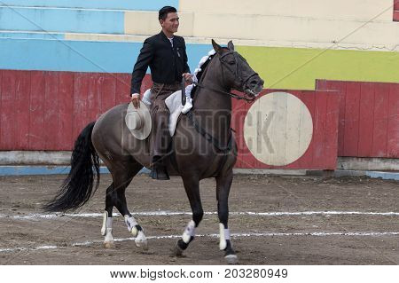 June 18, 2017 Pujili, Ecuador: bullfighter on horseback in the arena ready for the ritual show