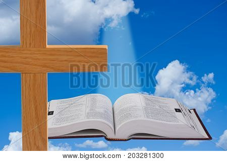 Christian Cross and Holy Bible in the Heavens..