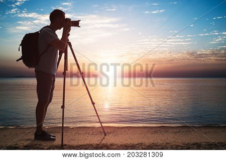 Man Photographing Using Tripod At Sea During Sunset In Egypt