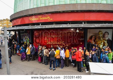 LONDON, UK - JULY 20, 2017: Tourists forming a large queue outside Madame Tussauds to see the exhibitions at the waxworks and planetarium