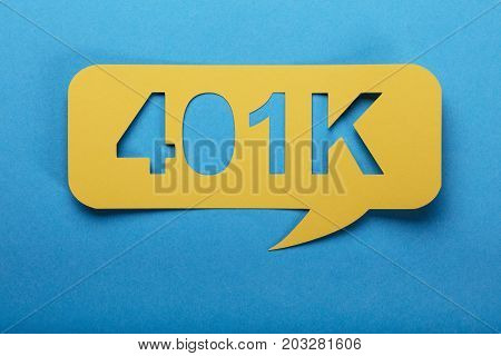 Yellow Speech Bubble With Text Of 401k Over Blue Background