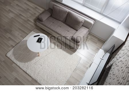 Elevated View Of Modern Apartment With Television And Sofa