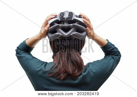 Back view of a woman wearing a bicycle helmet  Safe cycling on the road concept