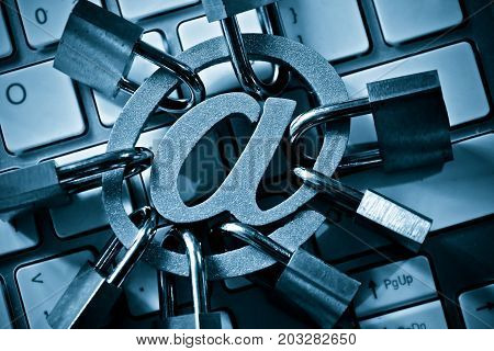 Email sign with many padlocks on computer keyboard / Email encryption security and countermeasure concept