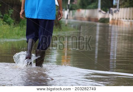 A man walking on the flooded road