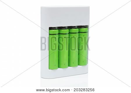 Green rechargeable aa battery in a charger - using environmentally friendly product concept