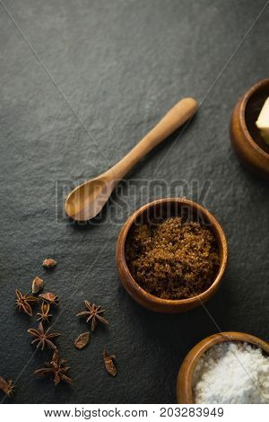 High angle view of grounded food in bowl by spice on table
