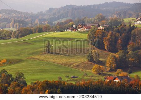 Beautiful Mountain Rural Autumn Landscape. Fantastic Views Of Austrian Green Hills.