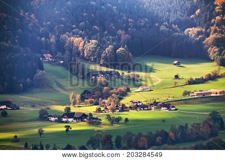 View Of Beautiful Mountain Rural Landscape In Alps With Village In Background