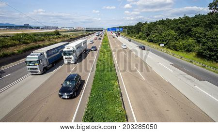 FRANKFURT GERMANY - JULY 11 2013: Traffic on a German highway. German autobahns have no general speedlimit and rank as the fifth longest highway system.