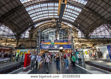 FRANKFURT GERMANY - JUL 11 2013: Inside the Frankfurt central train station. With about 350.000 passengers per day it's the most frequented railway station in Germany.