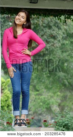 Female Youngster And Beauty and Wearing Blue Jeans
