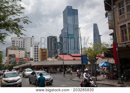 HO CHI MINH CITY (SAIGON), VIETNAM - JULY 2017: View of the streets and buildings of Ho Chi Min city(Saigon), with modern skyscrapers and Ben Thanh market.
