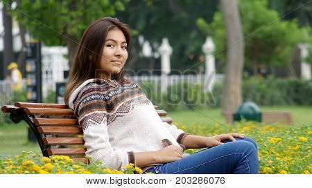 Sitting Peruvian Youngster Sitting in a Park