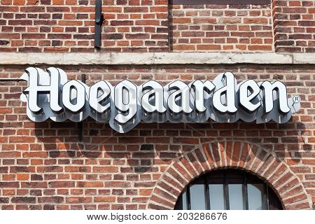 HOEGAARDEN, BELGIUM - SEPTEMBER 04, 2014: An inscription Hoegaarden on an old red brick wall. Hoegaarden Brewery is a brewery in Hoegaarden and the producer of a well-known wheat beer.