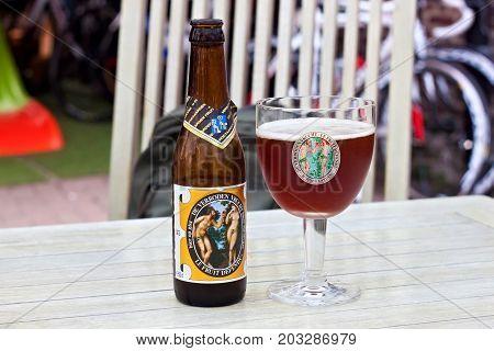 HOEGAARDEN, BELGIUM - SEPTEMBER 04, 2014: Bottle and the glass of the Hoegaarden