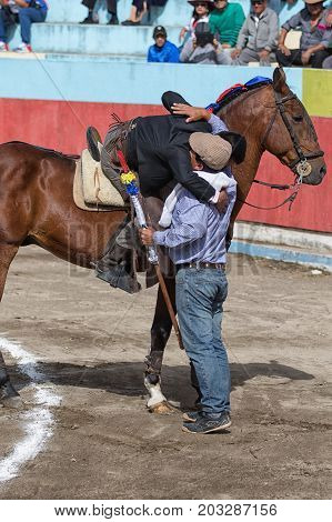 June 18 2017 Pujili Ecuador: bullfighter on horseback is getting ready for the ritual fight in the arena giving a good luck hug to a relative