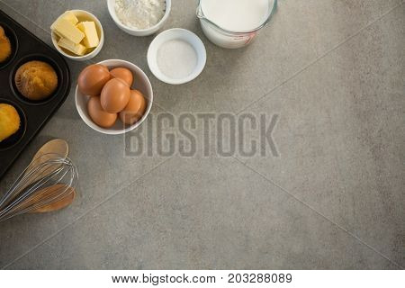 Ingredients by muffin tin on table