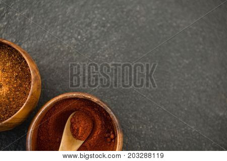 Overhead view of grounded food in wooden bowls on table