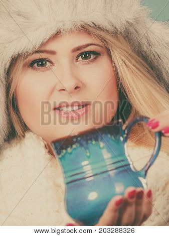 Woman In Winter Hat Drinking From Mug