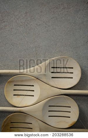 Directly above shot of spatulas arranged side by side on table
