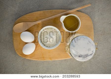 Directly above shot of ingredients on cutting board at table