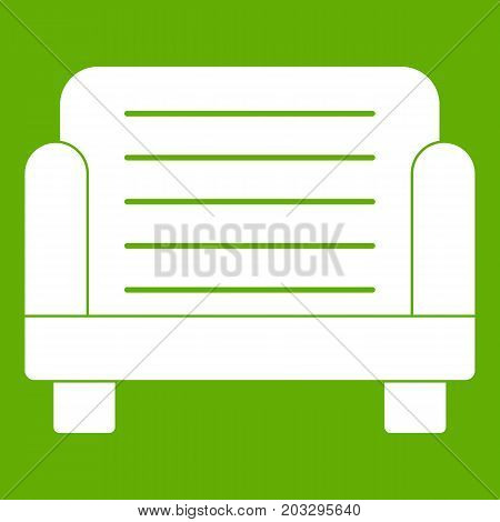 Armchair icon white isolated on green background. Vector illustration