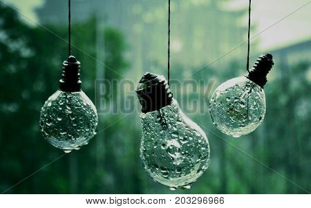 raining rain forest light bulbs hanging outside.
