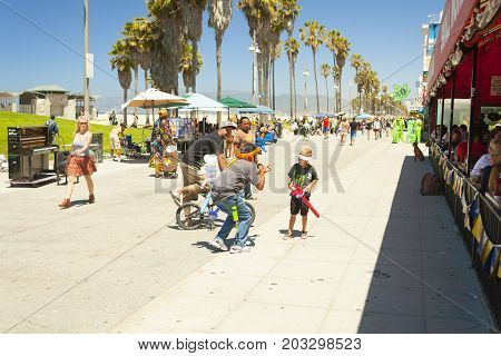 santa monica pier with families walking in an hot afternoon in summer  los angeles california