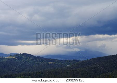 Wide shot of picturesque vista of Carpathian mountains. Cloudy weather