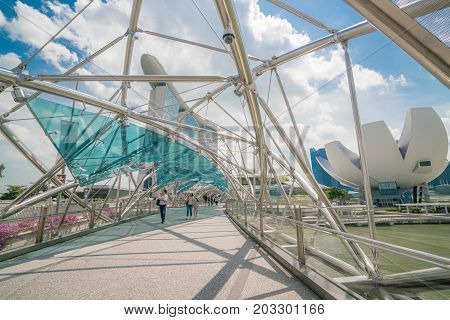 Tourist On Helix Bridge In Marina Bay, Singapore