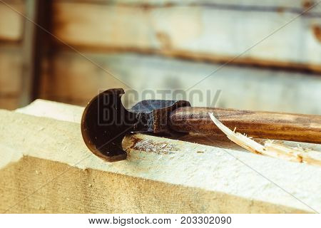 Rusty tip of sharp ax lies on edging boards
