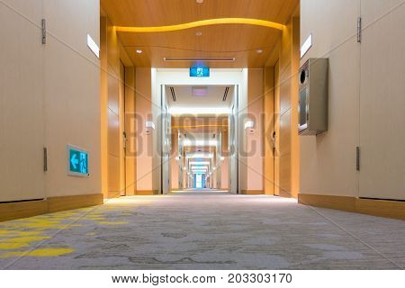Perspective view of corridor walkway in luxury hotel. Empty corridor in hotel.