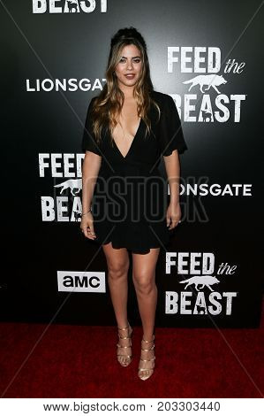 NEW YORK - MAY 23: Lorenza Izzo attends the AMC's 'Feed The Beast' premiere on May 23, 2016 in New York City.