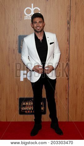 INGLEWOOD, CA - MAY 01: Singer Michael Ray poses in the press room at the 2016 American Country Countdown Awards at The Forum on May 01, 2016 in Inglewood, California.