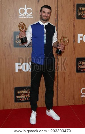 INGLEWOOD, CA - MAY 01: Singer Sam Hunt poses in the press room at the 2016 American Country Countdown Awards at The Forum on May 01, 2016 in Inglewood, California.