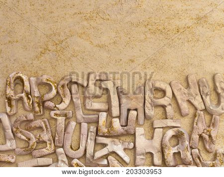 English alphabet, clay letters background