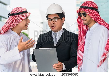 Multi Ethnic Businessmen Discussing On Constrcution Business