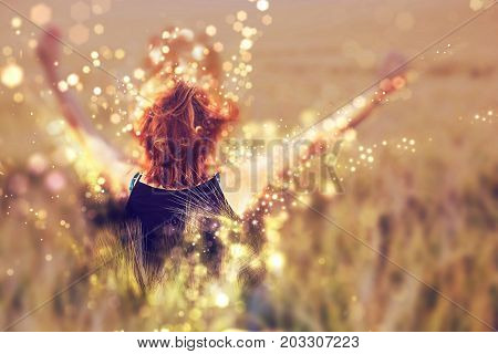 Young happy woman in the field by summer. Shimmering photo. Natural beauty. Red photo filter.