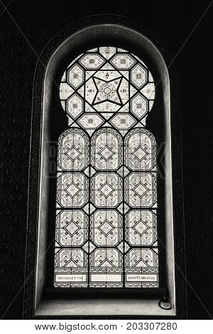 Artistic window in Spanish synagogue Prague Czech Republic. Religious architecture. Black and white photo.