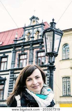 Tourist woman posing with historic building and old lantern in Main square Kosice Slovak republic. Tourism theme. Blue photo filter.