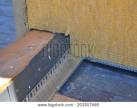 Closeup on Roof Corner Insulation and Waterproofing. Insulating Between and Under Roof Joists. Thermal Bridges Insulation