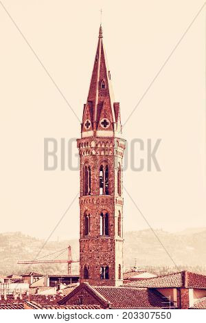 Badia Fiorentina is an abbey and church now home to the Fraternity of Jerusalem situated on the Via del Proconsolo in the centre of Florence Tuscany Italy. Travel destination. Red photo filter.