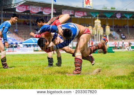 Naadam Festival Teenage Wrestling Throwing Mid-air