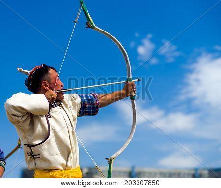 Naadam Festival Archery Man Pulling Bowstring Aim
