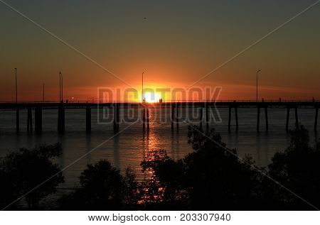 Sun setting behind the wharf in Derby, Western Australia